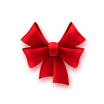 Fiocco rosso in seta regalo. decorazione a nastro in tessuto lucido sul regalo per il compleanno o il natale, elemento pacchetto vacanza vettoriale