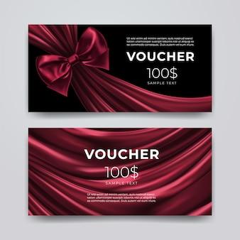 Modello struttura del buono regalo. set di carta promozionale premium con fiocco rosso scuro realistico e seta isolato su sfondo nero. buoni sconto, coupon o opuscolo. illustrazione 3d.