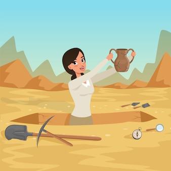 Ragazza archeologa fino in fondo alla fossa con la vecchia brocca in mano.