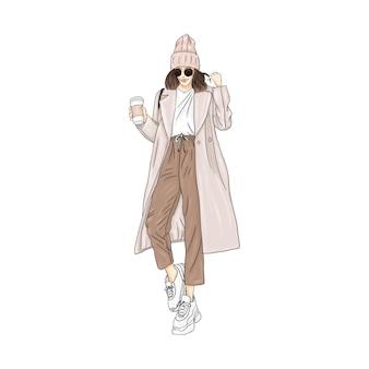 Ragazza in cappotto beige con caffè