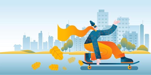 Una ragazza con una sciarpa luminosa cavalca rapidamente uno skateboard sullo sfondo della città