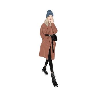 Ragazza in cappotto marrone