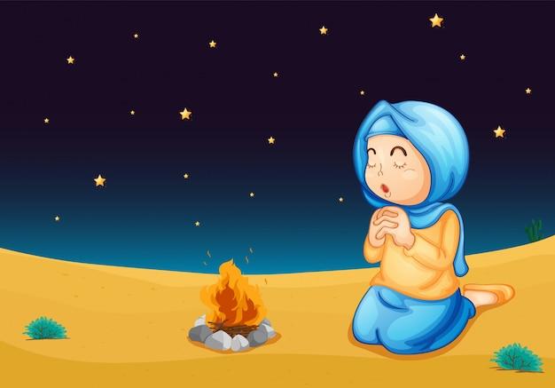 Una ragazza vicino al fuoco