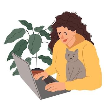 Ragazza al computer con un gatto