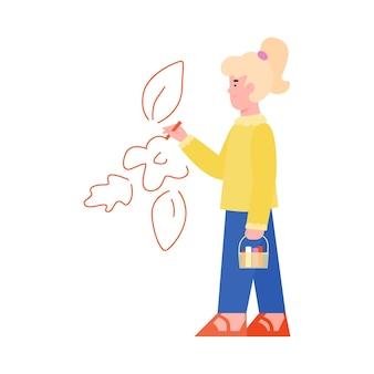La ragazza disegna un fiore rosso sul muro