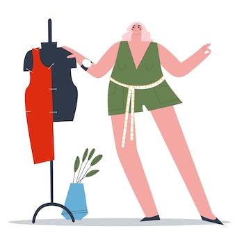 La sarta da ragazza appunta un pezzo di tessuto a un manichino da sarta t