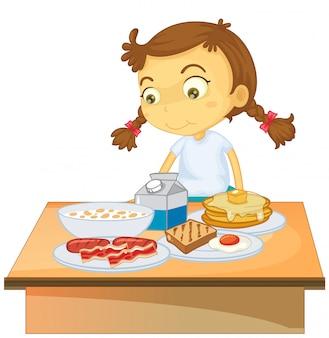 Una ragazza che mangia prima colazione su fondo bianco