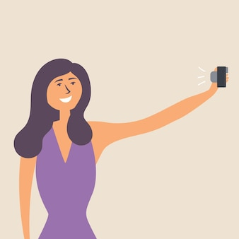 La ragazza ha allungato la mano con uno smartphone e si è fatta un selfie