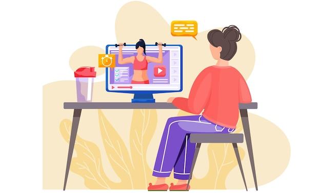 Una ragazza è seduta a un tavolo con un computer e un frullato di proteine