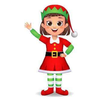 Ragazza ragazzino in vestito da elfo che dice ciao
