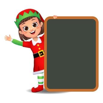 Ragazza ragazzino in abito da elfo con grande tavola