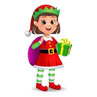 Ragazza ragazzino in abito da elfo con borsa regalo