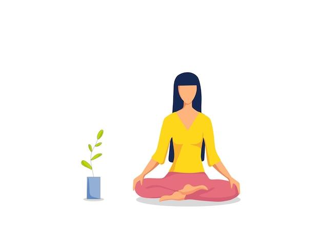 Una ragazza pratica esercizi di yoga su un tappetino a casa