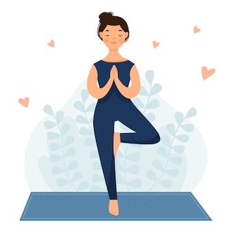 La ragazza pratica lo yoga la donna è in piedi su una gamba posa dell'albero