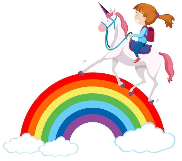 Ragazza che monta un unicorno sopra l'arcobaleno
