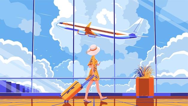 La ragazza atterrerà sull'aereo. volo aereo in aeroporto. imbarco su un volo. riposa in paesi caldi. bella ragazza in un vestito che cammina con i bagagli.
