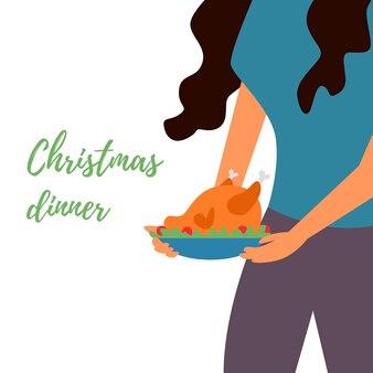 La ragazza prende il vassoio di pollo tacchino cibo delizioso cena di natale piatto festivo