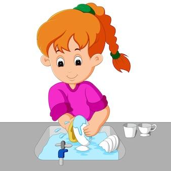 Ragazza che lava i piatti