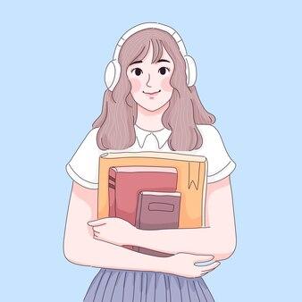 Ragazza che indossa le cuffie e tiene in mano l'illustrazione del fumetto dei libri di testo