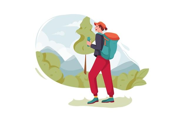 Ragazza con lo zaino che va per il trekking