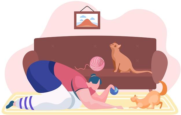 Ragazza con il gatto che riposa a casa. donna con il gomitolo di filo che gioca con il suo gattino. animale da addestramento in appartamento. personaggio femminile che gioca con un animale domestico. tempo divertente con il gatto. trascorrere del tempo con gli animali