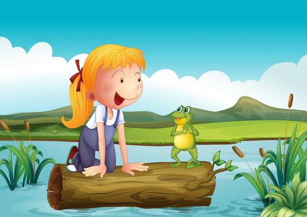 Una ragazza con una rana nel fiume