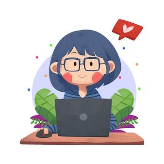 Una ragazza al lavoro che lavora con un computer portatile