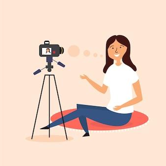 Ragazza scrive video blog fotocamera reflex