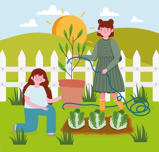 Ragazze che piantano lattuga