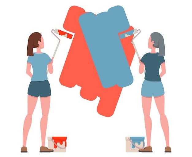 Ragazze con rullo e vernice per dipingere la parete