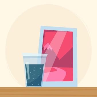 Bicchiere d'acqua e foto incorniciate su uno stile piatto mensola