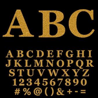 Alfabeto glitterato fatto di coriandoli dorati lucidi.