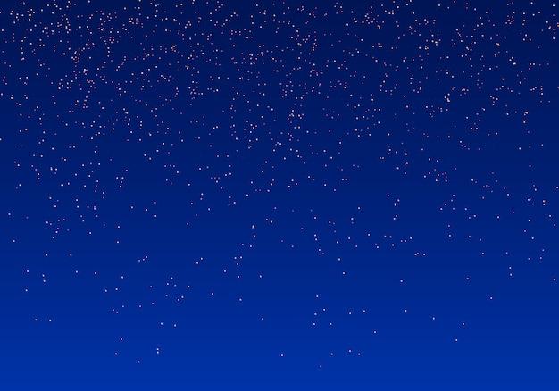 Scintille di particelle d'oro glitterate. polvere magica scintillante dorata. effetto luce su uno sfondo blu. scintille e stelle brillano di luce speciale.