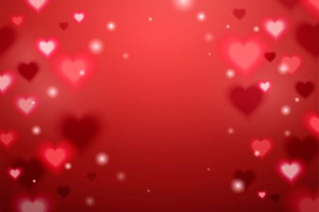 Sfondo di effetto a forma di cuore scintillante in rosso