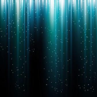 Bagliore di luce movimento astratto sfondo blu con linee e particelle di glitter.
