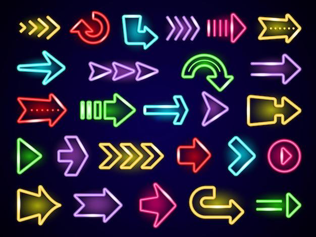 Glow frecce al neon. frecce di direzione della luce retrò fuori strada pubblicizzando elementi realistici al neon.