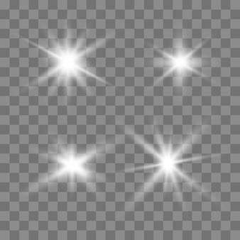 Effetto di luci incandescenti, bagliori, esplosioni e stelle. Vettore Premium