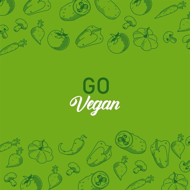 Vai a lettere vegane con cornice di verdure su sfondo verde