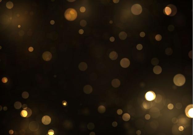 Bokeh dell'oro luce vaga su fondo nero. scintillio astratto sfocato stelle lampeggianti e scintille.