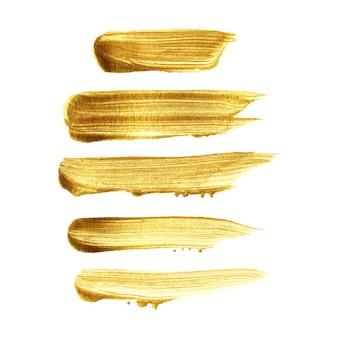 Insieme dipinto a mano del colpo della spazzola dell'oro isolato su fondo bianco