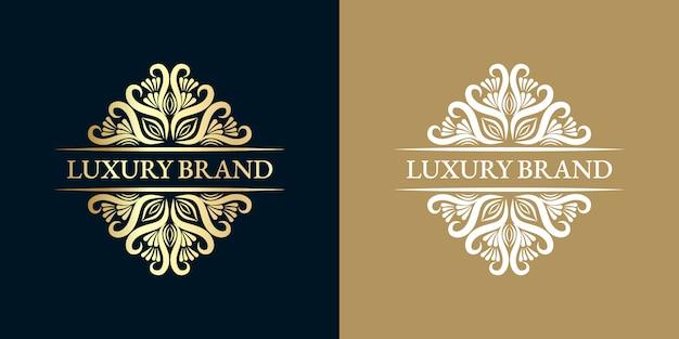 Monogramma araldico disegnato a mano floreale femminile calligrafico oro antico design logo di lusso in stile vintage