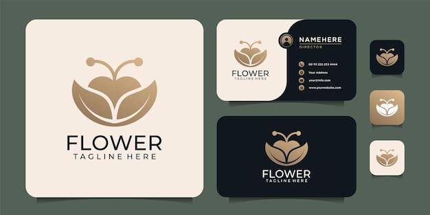 Design del logo della pianta del fiore femminile in oro per il negozio di spa salon
