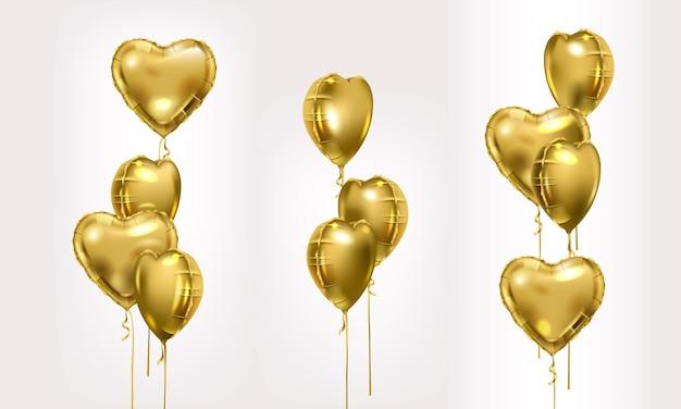 Set di palloncini d'aria in lamina d'oro. raccolta di diversi mazzo d'oro di palloncini a forma di cuore. composizioni per feste.