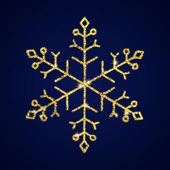 Fiocco di neve glitter oro su sfondo blu scuro