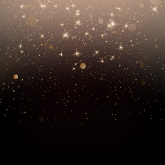 Polvere di stelle scintillanti d'oro particelle scintillanti su sfondo scuro.