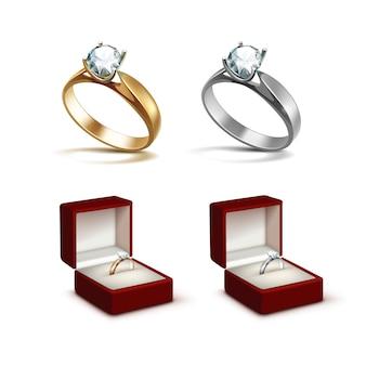 Anelli di fidanzamento in oro e argento con diamante chiaro lucido bianco in scatola di gioielli rosso close up isolato su sfondo bianco
