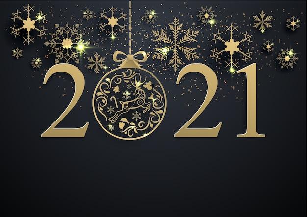 Fiocco di neve d'oro e decorazione palla di natale 2021 su sfondo nero, buon natale, felice anno nuovo.