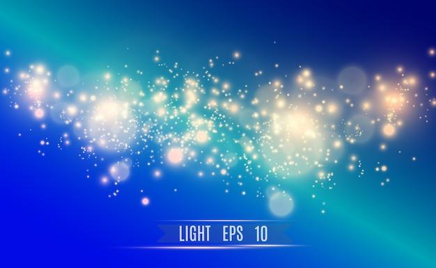 Scintille d'oro, magia, effetto di luce brillante su uno sfondo trasparente. polvere d'oro.