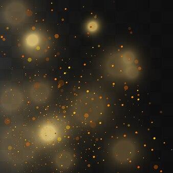 Scintille d'oro e stelle dorate brillano con un effetto speciale. brilla su sfondo trasparente.