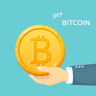 Bitcoin dorato nella mano di un uomo. mezzi di pagamento elettronici. capitalizzazioni di criptovaluta. moneta digitale.